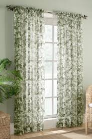 the fiji curtains featuring a lovely multi color leaf and stem print on a crushed voile sheer