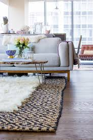 Jute Rug Living Room How To Layer Rugs Like A Pro The Fox She