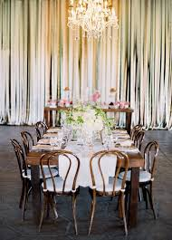 beautiful wedding ceremony decor with ribbon wall chandelier and pink flowers