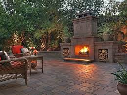 outdoor fireplace ideas this stone traditional with built in wood boxes will keep your patio warm