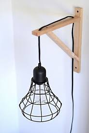caged lighting. diy cage light sconces use it by the couch with wrought iron instead of wood caged lighting e