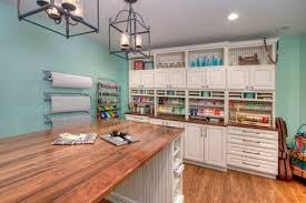 beautiful white craft room and home office with wrapping station with walls and dark wooden floors 12 colorful craft room with island work station 13 beautiful white home office