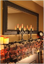 fireplace interior decorating with black bat garland and candle lighting