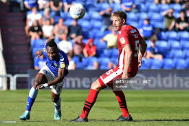 Oldham's Desire Segbe Azankpo and Morecambe's Steven Old in action... News  Photo - Getty Images