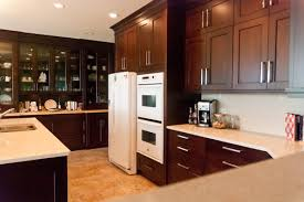 White Tile Floor With White Appliances ..small U Shaped Kitchen Idea.