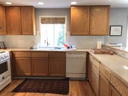 White Subway Backsplash How I Updated My Honey Oak Cabinets