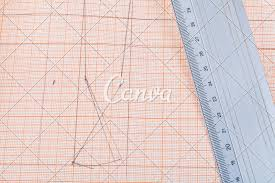 Metal Ruler At Graph Paper Photos By Canva