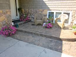 Stamped Concrete Front Stoop. Pattern is Random Stone, Colors are Doeskin &  Black http