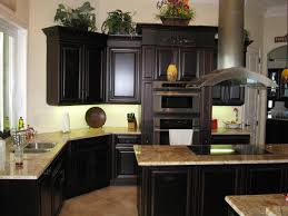 furniture black wooden kitchen cabinet and stainless steel on cream granite kitchen islands top