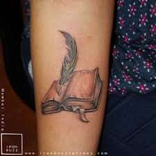 meval book quill tattoo on forearm