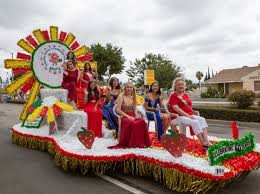 miss garden grove sarah bui at left top in the photo and the queen s court enjoy the parade at the 60th annual garden grove strawberry festival over the
