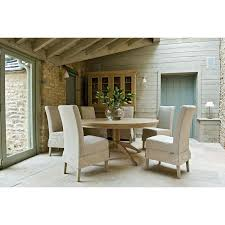 henley round six seater dining table shown here with long island upholstered dining chairs
