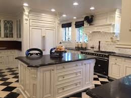 atlantic black granite ogee countertop white painted 1 inch thick plywood u shaped timeless kitchen cabinets tile ceramic floor chrome traditional knob