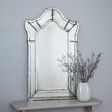 all glass venetial style mirror with curved top and aged glass