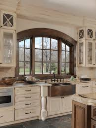 distressed kitchen cabinetry and copper sink