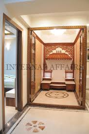 Mandir Designs In Living Room An Elegant Puja Room With Marble Floor And Hanging Bells And Idols