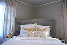 i m working with the white bedding tan linen curtains greenish gray walls and gray headboard