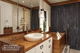 wood bath surround designed for an asian inspired style master bathroom with white cabinetry