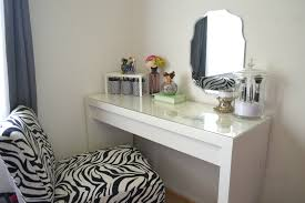simple diy white wood makeup vanity table with glass top and wall mounted mirror plus chair with fabric cover in the corner room ideas