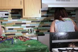 painting the tiles for affordable diy backsplash project
