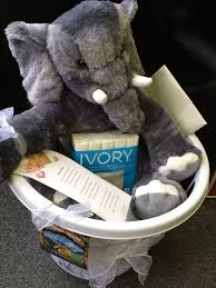 14th anniversary gift ivory is 14 year gift idea and so i did a little spin on this with ivory soap and a stuffed elephant basket
