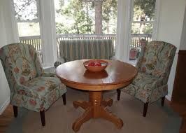 pair of greenwich parsons wing chairs fit nicely around a round table