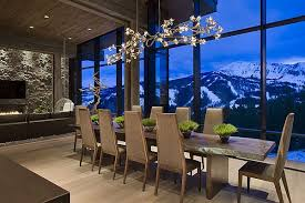 view in gallery mountain chalet with beautiful dining table and imposing chandelier