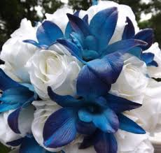white roses with blue orchid flowers