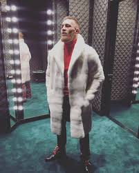 conor mcgregor wears gucci mink fur coat sweater pants shoes at ufc 205 press conference in nyc