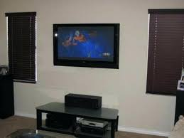 hanging flat screen tv mounting over brick fireplace placing above install on