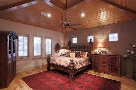 recessed lighting in vaulted ceiling for elegant bedroom design with wooden cupboard designs