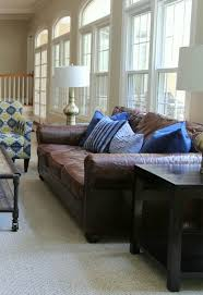 blue pillows on leather sofa