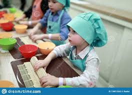 Sushi Cook Cook Rolling Mat Over Sushi Stock Photo Image Of Kitchen