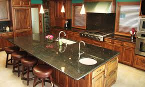 suede granite countertop and full height backsplash with undermount sink and half bull