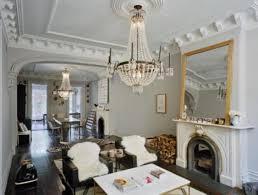 e f chapman paris flea market 8 light antique chandeliers in burnished brass shorn natural lambskin rug super plush white faux zebra hide rug medium