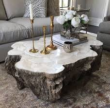 trunk shaped clam shell lava coffee table stonecast top with inlaid fossilized clam shell on stonecast base made to resemble tree trunk each piece varies