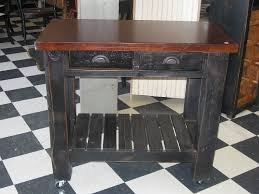 table 40 inches high. solid hardwood kitchen island; 2 drawers, towel bar. locking caster wheels. 36 table 40 inches high