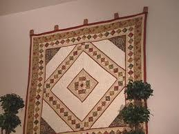 How to Make a Quilt Cl& Hanger | HGTV & rxr2213_3_quilthanger Adamdwight.com