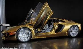 expensive cars with price. a model gold lamborghini aventador went on display at showroom in dubai to celebrate the expensive cars with price o