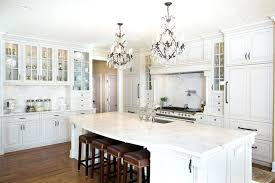 white kitchen designs luxury kitchen with white glass face cabinets marble counter island and two chandeliers