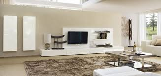 modern living room with glossy metal coffee table white tv stand white sofa and white bed sofa and brown rug image