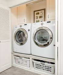 washer and dryer stands. Laundry Room With Elevated Washer/dryer Platform, Storage Space Underneath Washer And Dryer Stands