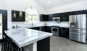 Black Marble Countertops Meridian Luxury Suites  With White Cabinets79
