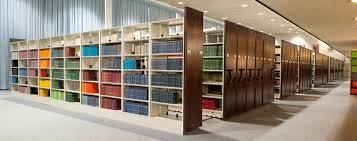 high density library shelving dark wood end panels