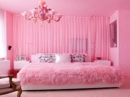Bedroom. pink wall theme and pink fabric curtains connected by pink  chandeliers lamp over pink