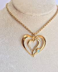 avon gold tone heart necklace