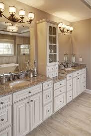granite countertops bathroom. traditional master bathroom with bathroom, specialty tile floors, complex granite counters, double sink, flush light countertops