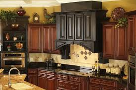 what to put above kitchen cabinets granite countertop brown wood cupboard chimney recessed lights tile backsplash