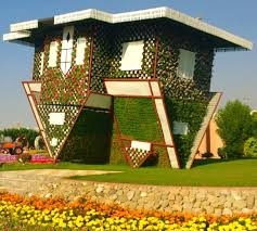 an upside down fl house at the dubai miracle garden