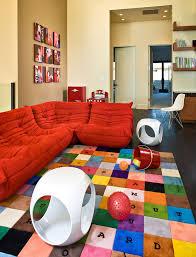 ligne roset sofa kids contemporary with area rug art bold colors bookshelves bright